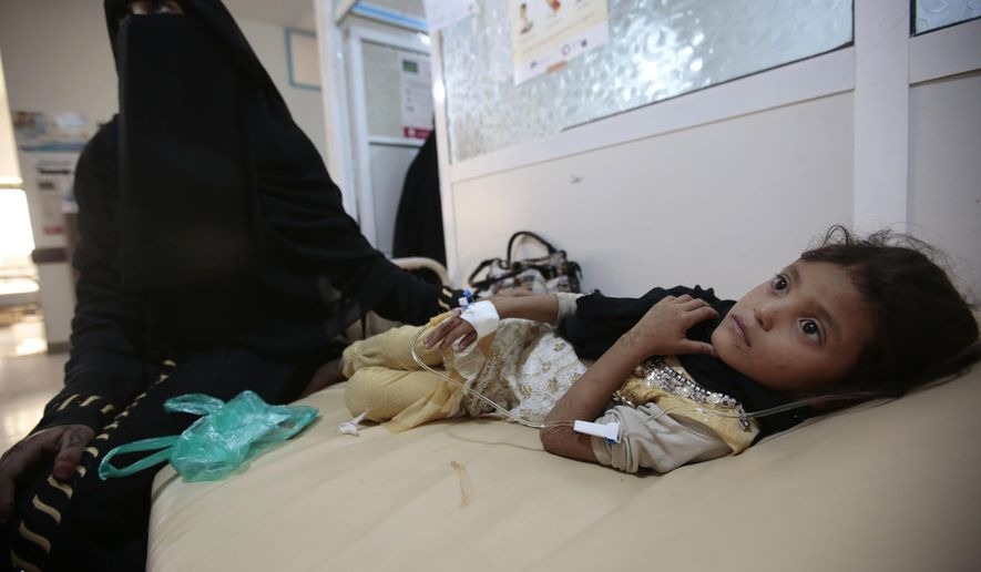 A girl is treated for suspected cholera infection at a hospital in Sanaa, Yemen, Saturday, Jul. 1, 2017. The World Health Organization says a rapidly spreading cholera outbreak in Yemen has claimed 1500 lives since April and is suspected of affecting 246,000 people. (AP Photo/Hani Mohammed)