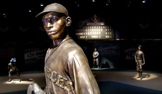 FILE - In this Jan. 27, 2005 file photo, bronze statues of Negro League greats including pitcher Satchel Paige, front, play their positions on the Field of Legends, which is the centerpiece of the Negro Leagues Baseball Museum in Kansas City, Mo. Major League Baseball is scheduled to play its annual All-Star game Tuesday, July 10, 2012, the museum will likely have experienced a significant windfall, financially and in terms of awareness, possibly ensuring its future for years to come. Museum officials expect to make upwards of $500,000 over the weekend. (AP Photo/Charlie Riedel, File)
