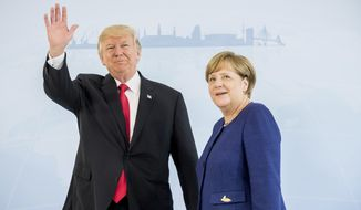 U.S. President Donald Trump, left, and German Chancellor Angela Merkel pose for a photograph prior to a bilateral meeting on the eve of the G-20 summit in Hamburg, northern Germany, Thursday, July 6, 2017. The leaders of the Group of 20 meet July 7 and 8. (Michael Kappeler/pool photo via AP)