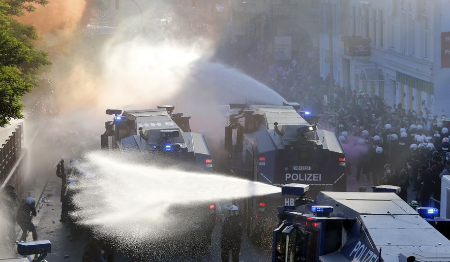 The Police uses water canons during a protest against the G-20 summit in Hamburg, northern Germany, Thursday, July 6, 2017. The leaders of the group of 20 meet July 7 and 8. (AP Photo/Michael Probst)