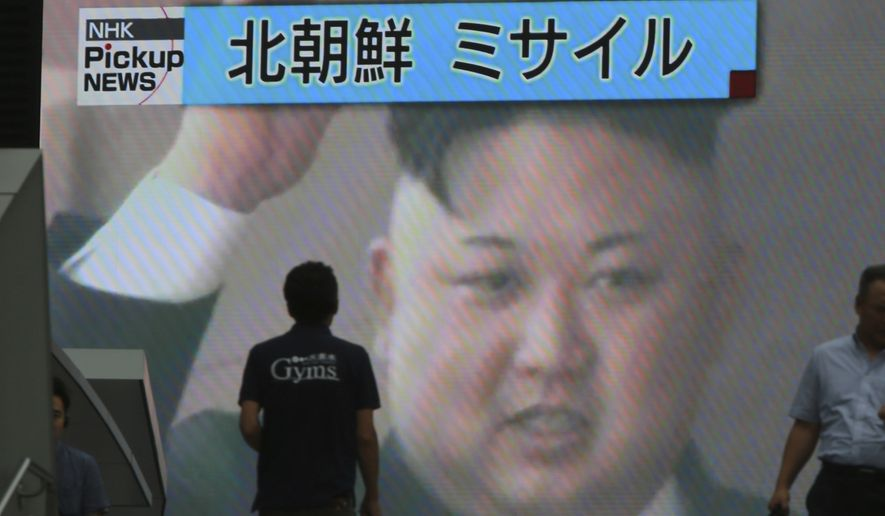 """An image of North Korean leader Kim Jong-un was shown on a large TV screen with news Tuesday of the country's first successful test of an intercontinental ballistic missile. The top banner reads: """"North Korea Missile."""" (Associated Press/File)"""