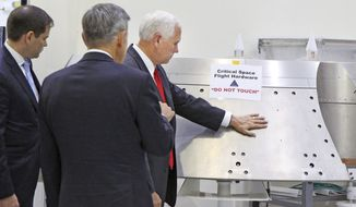 Vice President Mike Pence, right, gets a tour of the Orion spacecraft clean room with Sen. Marco Rubio, R-Fla., by Bob Cabana, director of the Kennedy Space Center, center, at the Kennedy Space Center in Cape Canaveral, Fla., on Thursday, July 6, 2017. Pence is leading a newly revived National Space Council. (Red Huber/Orlando Sentinel via AP)