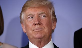 U.S President Donald Trump stands for a group photo prior to the Three Seas Initiative transatlantic roundtable in the Great Assembly Hall of the Royal Castle, in Warsaw, Thursday July 6, 2017.  The Three Seas Initiative is an alliance among a dozen eastern and central European nations that are bordered by the Adriatic, Baltic and Black seas. The group aims to reduce their dependence on oil and gas supplied by Russia. (AP Photo/Evan Vucci)