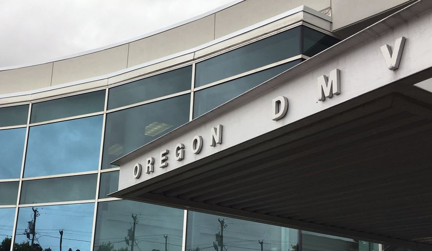 FILE--This June 15, 2017, file photo shows the headquarters of Oregon's Driver and Motor Vehicles Division in Salem, Ore. The Oregon Legislature on Thursday, July 6, passed a bill to allow local motor-vehicle offices to issue state driver's licenses and other forms of identification that comply with federal requirements borne out of 9/11 security concerns. (AP Photo/Andrew Selsky, File)