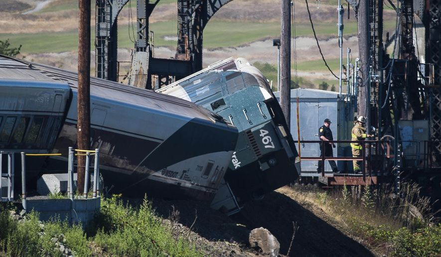 FILE - In this July 2, 2017 file photo, emergency crews respond to the scene of a train derailment near Chambers Bay in Tacoma, Wash. Some of the passengers suffered minor injuries. An Amtrak spokesman said Thursday, July 6, 2017, human error caused the accident. (Joshua Bessex/The News Tribune via AP, File)
