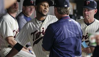 Minnesota Twins' Ervin Santana, center left, talks with pitching coach Neil Allen as Twins manager Paul Molitor, right, listens during the eighth inning of the team's baseball game against the Los Angeles Angels, Wednesday, July 5, 2017, in Minneapolis. The Angels won 2-1. (AP Photo/Paul Battaglia)