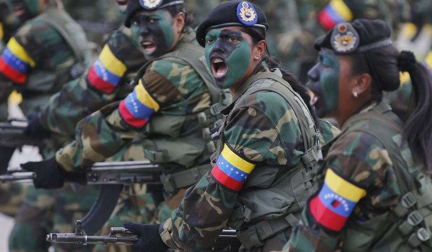 Female soldiers march during a military parade marking the country's Independence Day in Caracas, Venezuela, Wednesday, July 5, 2017. Venezuela is marking 206 years of their declaration of independence from Spain. (AP Photos/Ariana Cubillos)