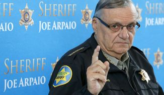 FILE - In this Dec. 18, 2013 file photo, Maricopa County Sheriff Joe Arpaio pauses as he answers a question at a news conference at Maricopa County Sheriff's Office Headquarters in Phoenix. Lawyers are scheduled to make closing arguments Thursday, July 6, 2017, at the criminal trial of the former six-term sheriff of metro Phoenix. Arpaio is charged with misdemeanor contempt-of-court for defying a judge's order to stop his traffic patrols that targeted immigrants. (AP Photo/Ross D. Franklin, File)