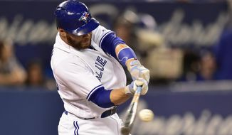 Toronto Blue Jays' Russell Martin hits a solo home run against the Houston Astros during the sixth inning of a baseball game in Toronto on Thursday, July 6, 2017. (Frank Gunn/The Canadian Press via AP)
