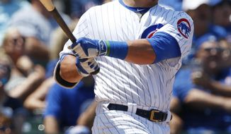 Chicago Cubs' Kyle Schwarber watches after hitting a foul ball during the second inning of a baseball game against the Milwaukee Brewers,Thursday, July 6, 2017, in Chicago. (AP Photo/Nam Y. Huh)
