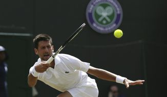 Serbia's Novak Djokovic returns the ball to Czech Republic's Adam Pavlasek during their Men's Singles Match on day four at the Wimbledon Tennis Championships in London Thursday, July 6, 2017. (AP Photo/Tim Ireland)