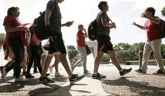 In this June 13, 2017 photo, University of Houston incoming students tour the campus as part of an orientation in Houston. (Elizabeth Conley/Houston Chronicle via AP)