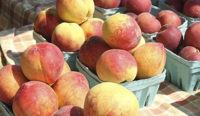 In this Friday, June 30, 2017 photo, peaches are displayed for sale at Ventnor Farmer's market at Holy Trinity Church in Ventnor, N.J. (Edward Lea/The Press of Atlantic City via AP)