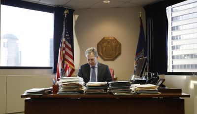 FILE- In this Feb. 17, 2017, file photo, New York State Attorney General Eric Schneiderman sits at his desk in his office in New York. Schneiderman's office considers Secretary of State Rex Tillerson a central figure in his expanding investigation into whether ExxonMobil misled investors about the impact of climate change. (AP Photo/Frank Franklin II, File)