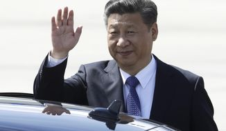 Chinese President Xi Jinping waves as he arrives for the G-20 summit in Hamburg, northern Germany, Thursday, July 6, 2017. The leaders of the group of 20 meet July 7 and 8. (AP Photo/Michael Sohn)
