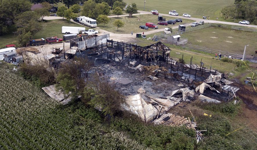 This Wednesday, July 5, 2017 photo shows the site where 18 horses died after a barn fire in Plainfield, Ill. Authorities say the horses died and two people were hurt after a morning blaze struck a horse-boarding barn in the southwestern Chicago suburbs. Plainfield Deputy Fire Chief Jon Stratton says 30 horses were in the barn when the fire started but a dozen survived because owners and firefighters were able to let them out. The cause of the blaze is under investigation. (Mark Welsh/Daily Herald via AP)
