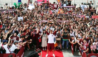 Germany's Lukas Podolski, front center, poses for photos with fans during a welcoming ceremony in Kobe, western Japan Thursday, July 6, 2017. Podolski will play for Japanese club Vissel Kobe. (Tsuyoshi Ueda/Kyodo News via AP)