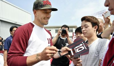 Germany's Lukas Podolski gives his autographs to fans during a welcoming ceremony in Kobe, western Japan Thursday, July 6, 2017. Podolski will play for Japanese soccer club Vissel Kobe. (Tsuyoshi Ueda/Kyodo News via AP)