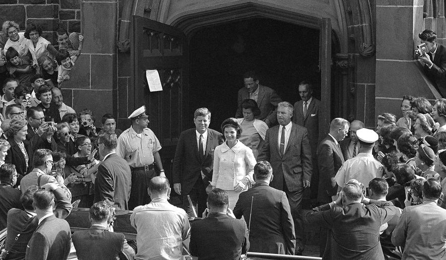 FILE - In this Oct. 1, 1961 file photo, President John F. Kennedy and first lady Jacqueline Kennedy leave St. Mary's Church in Newport, R.I., after Mass. The Rhode Island church, where the Kennedys wed on Sept. 12, 1953, is inviting visitors in to kneel where the couple knelt, listen to the music that played and imagine the day. (AP Photo/File)