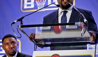FILE - In this Jan. 11, 2017, file photo, entertainer Ice Cube, right, announces the launch of the Big3 professional basketball league as former NBA player and players union deputy Roger Mason, left, looks on, in New York. Ice Cube says his Big3 basketball league is open to moving its championship game to another arena in Las Vegas to make way for Floyd Mayweather's boxing match against Conor McGregor. The game is scheduled for Aug. 26 at T-Mobile Arena, the biggest venue in Las Vegas. Mayweather's fight against McGregor was later announced for the same site. (AP Photo/Bebeto Matthews)