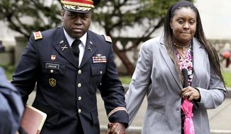 FILE - In this May 9, 2013, file photo, John Jackson, left, and his wife Carolyn Jackson, of Mount Holly, N.J., walk out of Martin Luther King, Jr. Courthouse in Newark, N.J. A federal appeals court ordered a new sentencing for the former Army major and his wife on Thursday, July 6, 2017. A jury in 2015 sentenced John Jackson to probation and Carolyn Jackson to two years in prison after convicting them of abusing their three young foster children over several years. (AP Photo/Julio Cortez, File)