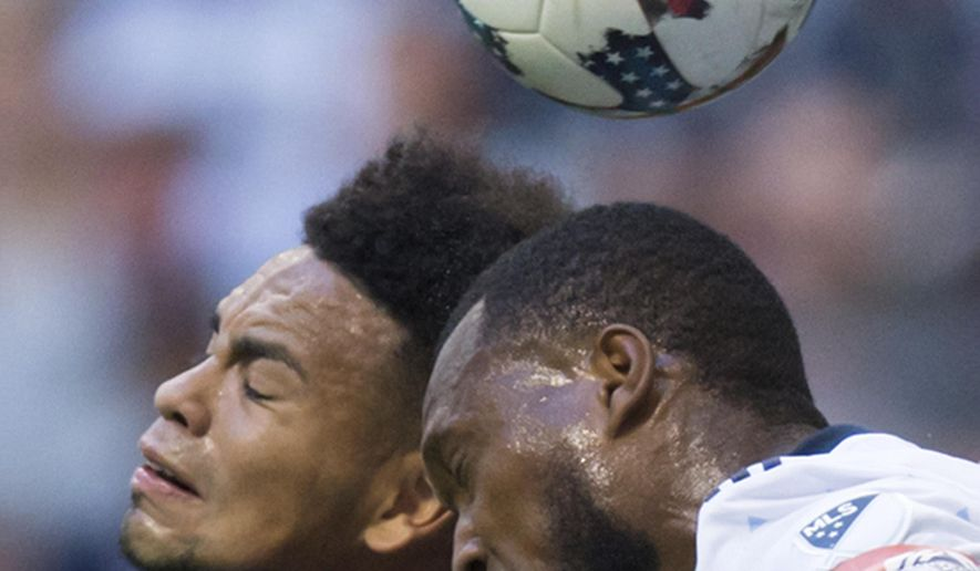 New York City FC's Alexander Callens, left, and Vancouver Whitecaps' Kendall Waston vie for the ball during the second half of an MLS soccer match Wednesday, July 5, 2017, in Houston. (Yi-Chin Lee/Houston Chronicle via AP)