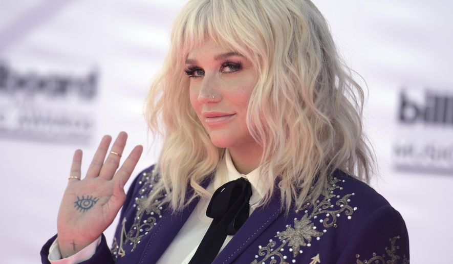 """FILE - In this May 22, 2016, file photo, Kesha arrives at the Billboard Music Awards at the T-Mobile Arena in Las Vegas. Kesha released """"Praying"""" on July 6, 2017. The song is the lead single from the singer's first album in five years. (Photo by Richard Shotwell/Invision/AP, File)"""