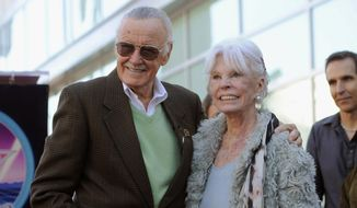 In this Jan. 4, 2011, file photo, comic book creator Stan Lee, left, poses with his wife Joan after he received a star on the Hollywood Walk of Fame in Los Angeles. Lee and his family announced that Joan Lee died peacefully on Thursday, July 6, 2017, and asked for privacy. Stan and Joan Lee had been married for 69 years, and the famed comics creator had credited his wife with being supportive during an early part of his career when he was struggling to create superheroes he and audiences would care about. (AP Photo/Chris Pizzello, File)