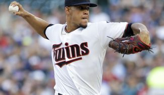 Minnesota Twins starting pitcher Jose Berrios throws during the during the first inning of the team's baseball game against the Baltimore Orioles, Thursday, July 6, 2017, in Minneapolis. (AP Photo/Paul Battaglia)