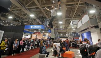 FILE - In this Jan. 11, 2017, file photo, people attend the Outdoor Retailer show at the Salt Palace Convention Center in Salt Lake City. Organizers announced Thursday, July 6, 2017, that the show will be held in Denver starting in 2018. The retailers are leaving Utah after 20 years because of political differences with Utah leaders, including their opposition to the new Bears Ears National Monument.  (AP Photo/Rick Bowmer, File)