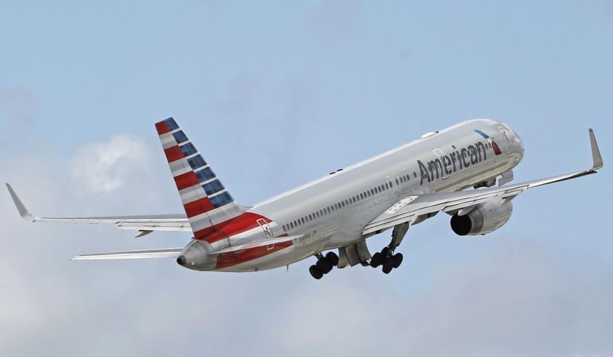 """FILE - In this Friday, June 3, 2016, file photo, an American Airlines passenger jet takes off from Miami International Airport in Miami. American Airlines tells Chicago's WBBM-TV that a """"disruptive passenger"""" was removed from an Atlanta to Chicago flight on Wednesday, July 5, 2017. Video shows passengers yelling at a fellow passenger who followed a flight attendant while letting her dog run through the cabin without a leash.(AP Photo/Alan Diaz, File)"""