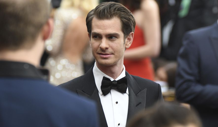 """FILE - In this Feb. 26, 2017, file photo, Andrew Garfield arrives at the Oscars at the Dolby Theatre in Los Angeles. Garfield is getting criticized after Britain's Gay Times reported July 3, 2017, that he told an audience he was gay, but """"without the physical act."""" (Photo by Al Powers/Invision/AP, File)"""