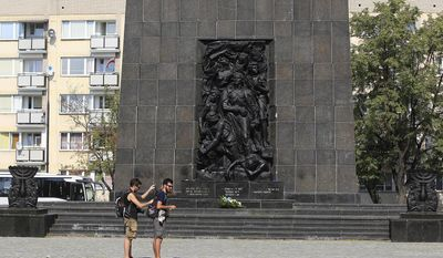 FILE - In this Aug 12, 2015 picture two tourists visit the monument to the Jews who fought and died in the Warsaw Ghetto Uprising of 1943 in Warsaw, Poland. Ivanka Trump and her husband Jared Kushner, senior advisor of President Donald Trump visited the Warsaw 1943 Ghetto Heroes Memorial, Thursday, July 6, 2017. (AP Photo/Czarek Sokolowski, file)