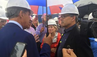 Energy Secretary Rick Perry, right, talks with Sen. Joe Manchin, D-W.Va., left, and Sen. Shelley Moore Capito, R-W.Va.  outside the coal-burning Longview Power Plant in Maidsville, W.Va., Thursday, July 6, 2017. (AP Photo/Michael Virtanen)