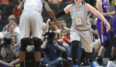 Minnesota Lynx guard Lindsay Whalen celebrates a basket during the second quarter against the Los Angeles Sparks in a WNBA basketball game Thursday, July 6, 2017, in St. Paul, Minn. (Elizabeth Flores/Star Tribune via AP)