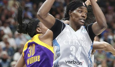 Minnesota Lynx center Sylvia Fowles, right, grabs the ball next to Los Angeles Sparks forward Nneka Ogwumike during the first half of a WNBA basketball game Thursday, July 6, 2017, in St. Paul, Minn. (Elizabeth Flores/Star Tribune via AP)
