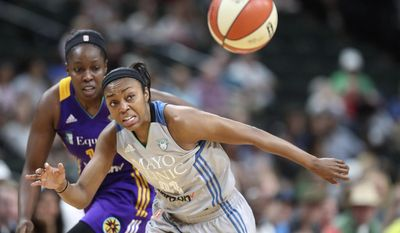 Minnesota Lynx guard Renee Montgomery, right, and Los Angeles Sparks guard Chelsea Gray watch the ball get away during the second quarter of a WNBA basketball game Thursday, July 6, 2017, in St. Paul, Minn. (Elizabeth Flores/Star Tribune via AP)