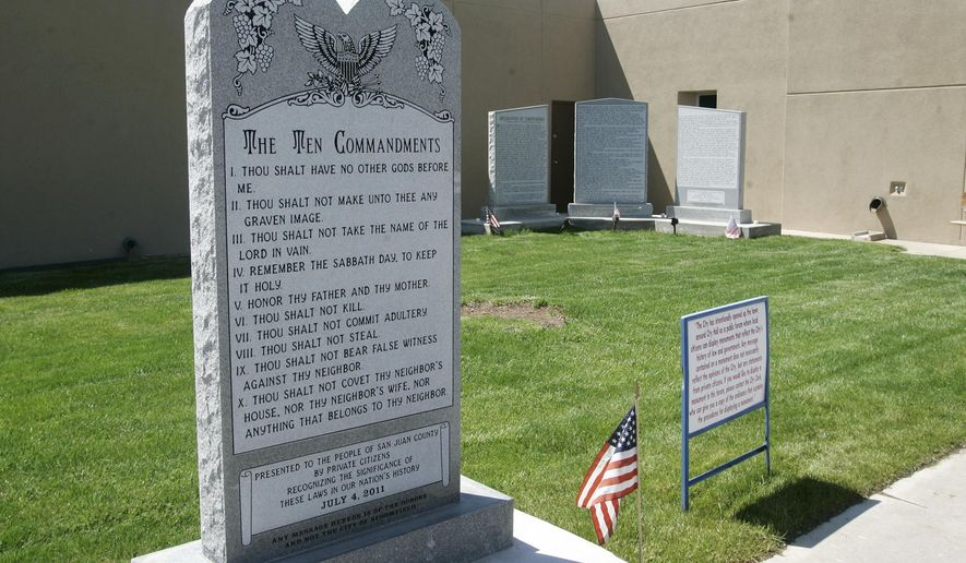 FILE- This May 15, 2012, file photo shows the Bloomfield Ten Commandments monument at the City Hall in Bloomfield, N.M. Attorneys representing the city of Bloomfield filed a petition with the nation's highest court Thursday, July 6, 2017, asking the U.S. Supreme Court to hear its appeal of a lower court ruling requiring the removal of a Ten Commandments monument outside City Hall. (Jon Austria/The Daily Times via AP, File)