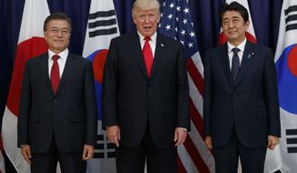 President Donald Trump meets with Japanese Prime Minister Shinzo Abe, right, and South Korean President Moon Jae-in before the Northeast Asia Security dinner at the US Consulate General Hamburg, Thursday, July 6, 2017, in Hamburg. (AP Photo/Evan Vucci)