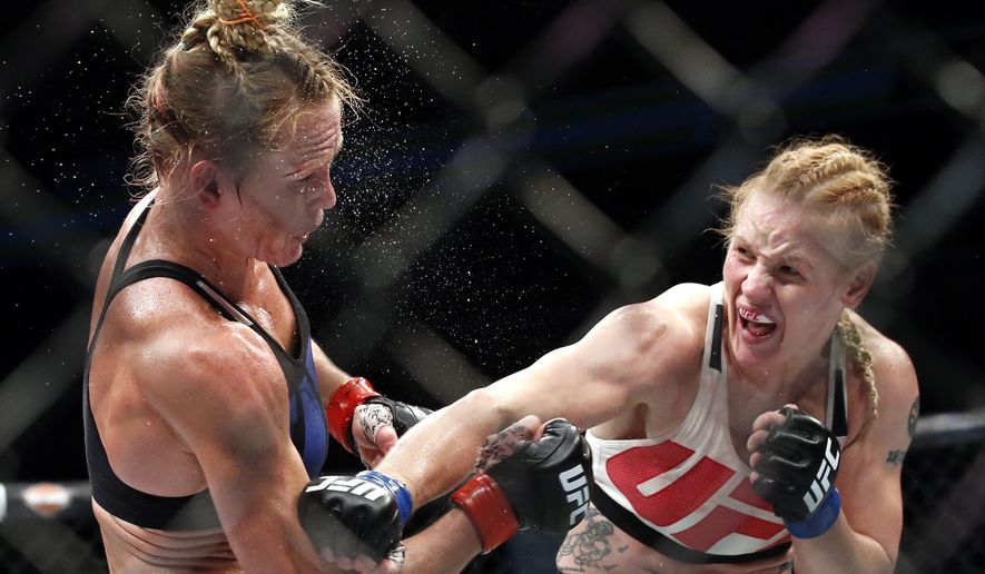FILE - In this July 23, 2016, file photo, Valentina Shevchenko, right, of Kyrgyzstan, follows through on a punch to Holly Holm during a women's bantamweight mixed martial arts bout in Chicago. Shevchenko is a Soviet-born Peruvian from Kyrgyzstan who does her mixed martial arts training in Thailand and the U.S. This avid traveler, dance contest winner and recent restaurant shooting survivor also might be the UFC's new bantamweight champion after her rematch with Amanda Nunes on Saturday, July 8, 2017. (AP Photo/Nam Y. Huh, File)
