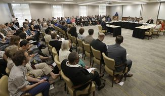 In this photo taken May 11, 2017, a crowded room of concerned citizens listen during a public forum in Chapel Hill, N.C., regarding the UNC Center for Civil Rights ability to represent poor and minority clients in court. (AP Photo/Gerry Broome)