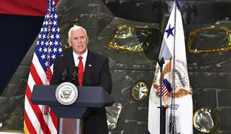 Vice President Mike Pence speaks inside the Vehicle Assembly Building at the Kennedy Space Center in Cape Canaveral, Fla., on Thursday, July 6, 2017. Pence is leading a newly revived National Space Council. In the background is a NASA Orion capsule that has flown in space. (Malcolm Denemark/Florida Today via AP)