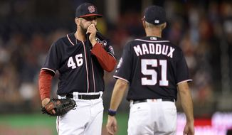 Washington Nationals pitching coach Mike Maddux (51) walks to the mound to meet with relief pitcher Oliver Perez (46) during the eighth inning of a baseball game against the Atlanta Braves, Friday, July 7, 2017, in Washington. (AP Photo/Nick Wass)