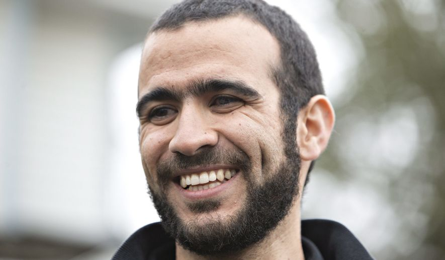 In this May 7, 2015, file photo, former Guantanamo Bay prisoner Omar Khadr speaks to media outside his lawyer Dennis Edney's home in Edmonton, Alberta. Khadr, who pleaded guilty to killing a U.S. soldier in Afghanistan, has received a multimillion-dollar payment from Canada's government after a court ruling said his rights were abused, a Canadian official said Thursday night, July 6, 2017. (Jason Franson/The Canadian Press via AP, File)
