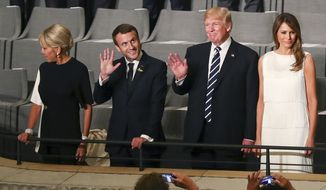US-President Donald Trump, 2nd right, and his wife Melania, right, as well as French President Emmanuel Macron, 2nd left, and his wife Brigitte arrive at the Elbphilharmonie concert hall on the occasion of the G-20 summit in Hamburg, Germany, Friday, July 7, 2017. (Christian Charisius/Pool Photo via AP)