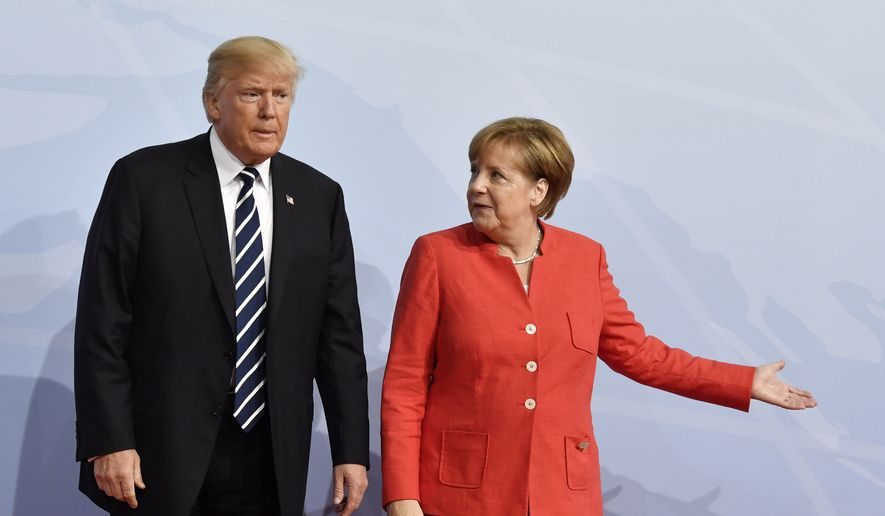 German Chancellor Angela Merkel, right, greets U.S. President Donald Trump at the start of the G-20 meeting in Hamburg, northern Germany, on Friday, July 7, 2017. Leaders of the world's top economies will gather from July 7 to 8, 2017. (John MacDougall/Pool Photo via AP)