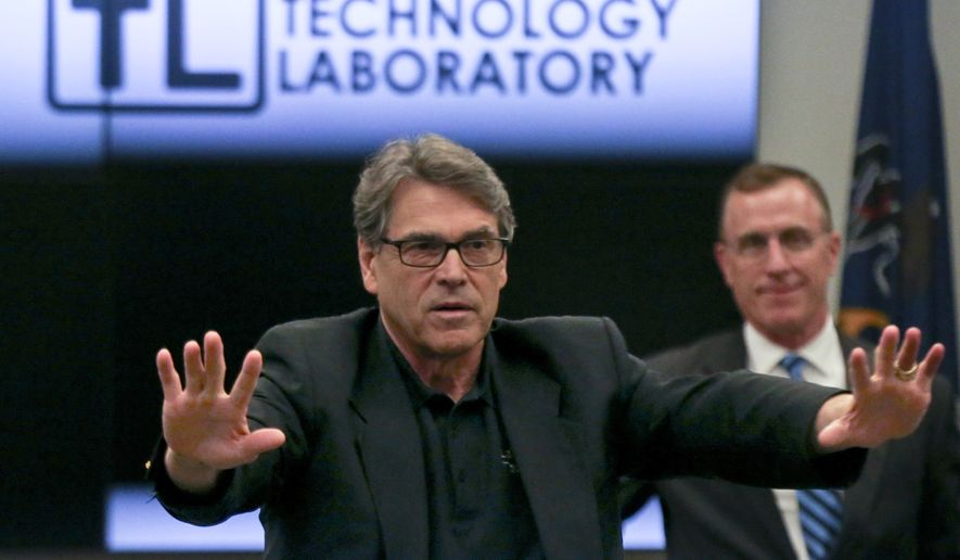 Department of Energy Secretary Rick Perry, left, talks to employees during a visit to the National Energy Technology Laboratory (NETL) Pittsburgh site, Friday, July 7, 2017, in South Park Township, Pa. south of Pittsburgh. U.S. Rep. Tim Murphy, R- Pa., is at right. (AP Photo/Keith Srakocic)
