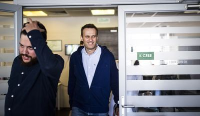 Russian opposition leader Alexei Navalny smiles arriving to his office in Moscow, Russia, on Friday, July 7, 2017. Alexei Navalny, the Russian anti-corruption campaigner who is the most persistent thorn in the Kremlin's side, has been released from jail after serving 25 days for organizing a wave of protests. (Evgeny Feldman/Pool Photo via AP)