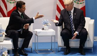 President Donald Trump meets with Mexican President Enrique Pena Nieto at the G20 Summit, Friday, July 7, 2017, in Hamburg. (AP Photo/Evan Vucci)