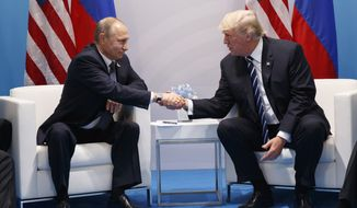 President Donald Trump shakes hands with Russian President Vladimir Putin at the G-20 Summit, Friday, July 7, 2017, in Hamburg. (AP Photo/Evan Vucci)